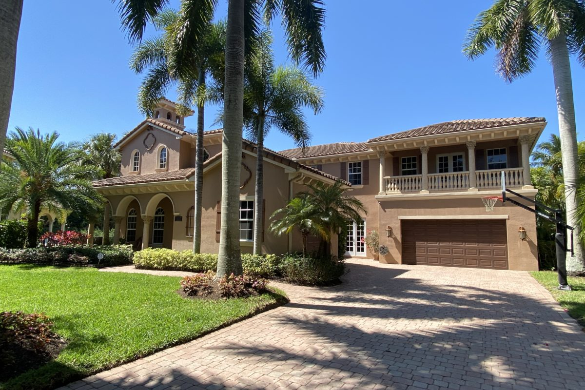 view of large estate home located in Valencia at Abacoa Jupiter Fl