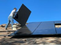 Installing solar panels on roof of house in florida