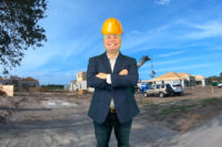 funny photo of realtor david rogers with hardhat on