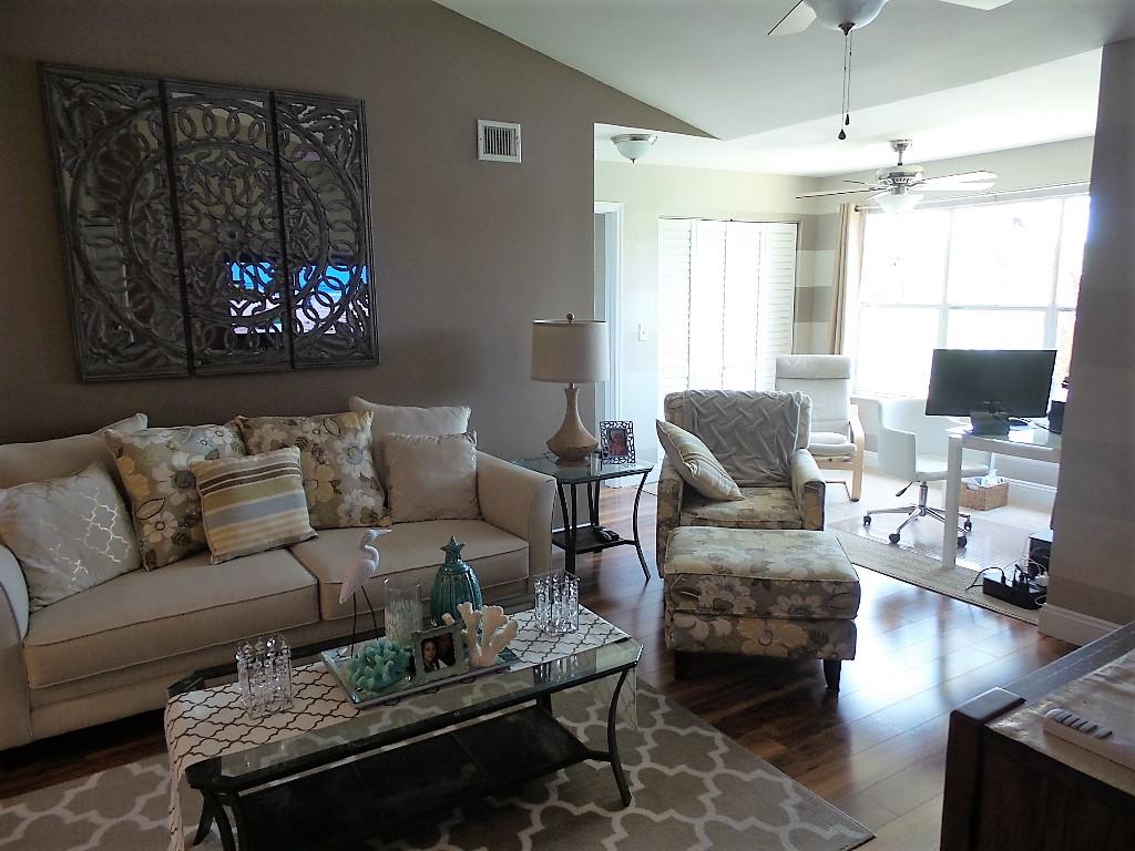 living room and sun room view isles at lago mar condominium sunrise florida